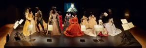 The Queen Elizabeth plinth in Act I shows costumes from each film made about the monarch and shows how costumes change according to cultural preoccupations of the day.